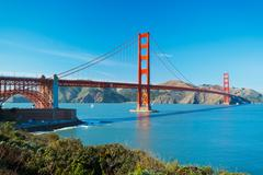 Stock Photo of the golden gate bridge in san francisco with beautiful blue ocean in backgrou
