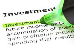 'investment' highlighted in green - stock photo