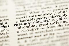 'misery' - dictionary definition Stock Photos