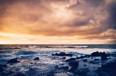 Stock Photo of storm on the sea, ocean storm at sunset