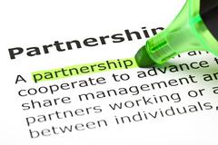 'partnership' highlighted in green - stock photo
