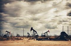 Oil field in desert, oil production Stock Photos