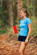 runner on water break - stock photo