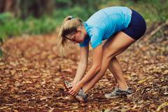 runner stretching - stock photo