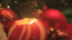 red striped ball candle and red baubles - stock footage