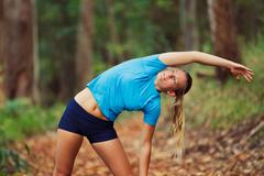 Young woman stretching after workout run Stock Photos