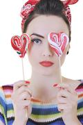 Stock Photo of happy woman with lollipop isolated on white