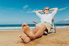 young attractive man relaxing at the beach - stock photo