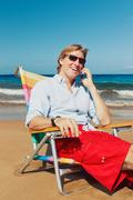 Stock Photo of business man on the beach in hawaii