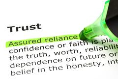 'assured reliance' highlighted, under 'trust' - stock photo