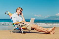 business man on the beach in hawaii - stock photo