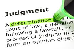 'determination' highlighted, under 'judgment' - stock photo