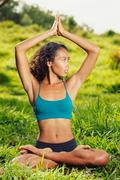 beautiful woman practicing yoga outside in nature - stock photo