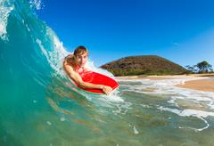 Boogie boarder surfing amazing blue ocean wave Stock Photos