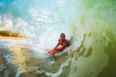Body boarder surfing blue ocean wave Stock Photos
