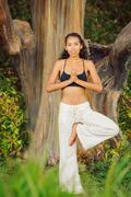 Stock Photo of yoga woman outside in nature