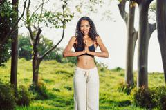 yoga woman outside in nature - stock photo