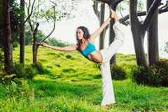 Yoga woman outside in nature Stock Photos