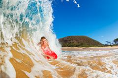 Body boarder surfing blue ocean wave Stock Photos
