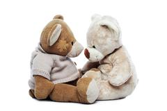two teddy bears looking each other - stock photo