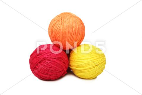 Stock photo of colorful yarn balls over white