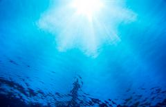 under water light rays - stock photo