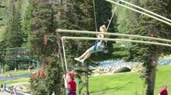 Girl friends jump ride summer resort HD 2782 Stock Footage
