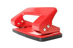 Stock Photo of red office paper hole puncher