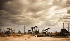 Oil field in desert Stock Photos