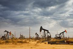 oil field in desert - stock photo