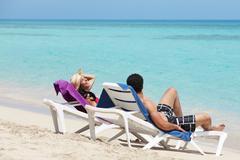 Man and woman doing honeymoon in cuba Stock Photos