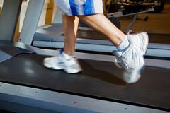 man running on treadmill - stock photo
