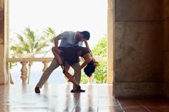 Latin american man and woman dancing Stock Photos