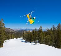skier gets big air off jump - stock photo