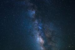 Night sky, bright stars and milky way galaxy Stock Photos