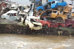 1119955-car-wrecks-on-the-river.jpg - stock photo