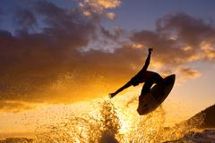 sunset surfer - stock photo