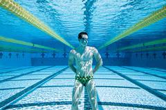swimmer in pool underwater - stock photo