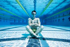 Swimmer in pool underwater Stock Photos