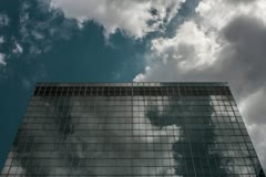 Corporate Building Time-Lapse with Clouds Moving Fast in 4K - stock footage