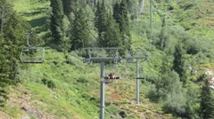 Husband wife summer mountain resort ski lift HD 2773 Stock Footage