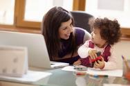 Stock Photo of multitasking mother with her daughter