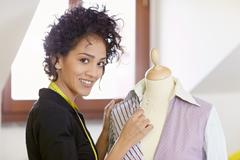 woman working in fashion design studio - stock photo