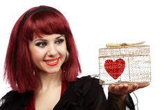 Happy girl with heart in a golden gift box Stock Photos
