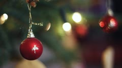 Close-up of christmas ornaments hanging on the tree Stock Footage