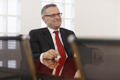 Businessman in corporate meeting Stock Photos