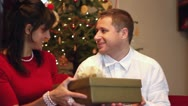 Young woman opening x-mass present Stock Footage
