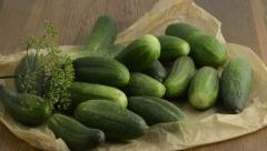 falling cucumber on a paper with dill spice - stock footage