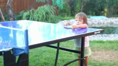 Child playing ping-pong Stock Footage
