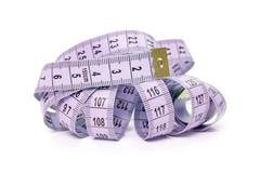 purple measure tape - stock photo